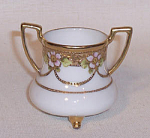 Nippon R.C, footed with gold floral band and 2 gold decorated handles. Mark 80. This is the very one pictured in the 1991 club book. Listed as H4 #461. Purchased at a Hirchack Auction in Stowe Vermont.