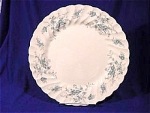 <b>Beautful blue flowers adorn this scalloped edged dinner plate.   