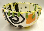 <b>Small expressive multi-colored spatterware bowl is a treat for the eyes and the hands with its vivid colors and varied textures.    <u>Colors:</u>   Green, Yellow, Black, Orange and White.  Maker: Unknown