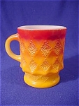 <b>Two-tone orange/red coffee cup with diamond pattern. 