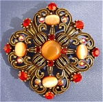 Click to view larger image of Orange Passion Vintage Inspired Catseye Brooch (Image1)