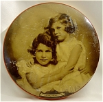 <b>Princess Elizabeth and Princess Margaret Rose (from a portrait by Marcus Adams) are pictured  on the front of Riley's Toffee tin. 