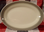 <b>Bone chna restaurant ware.  Oval shape.  Gray trim on the outer edge.  Maker's mark:  Bone China Homer Laughlin China Made in USA G L   Very light utensil markings.  Only can be seen when light is reflected off the plate.