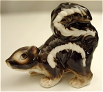 Click here to enlarge image and see more about item 101: Miniature Porcelain Papa Skunk