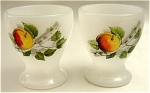 <b>This stunning pair of egg cups has a rich apple tree design set against a milk white glass background.