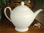 <b>Beautiful cream color teapot with an embossed ribbing and dots design. 