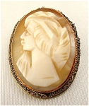 <b>Beautifully carved female portrait set in copper and vermeil. 