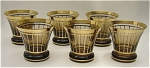 <b>This is a very nice set of six shot glasses with an Art Deco design.    Beautiful smoked brown color with gold trim.  These shot glasses features a flat base with a narrow body that bows to a wider mouth.