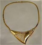 Click here to enlarge image and see more about item 225: 1980s Art Deco Style Golden Trifari Necklace