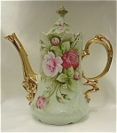 <b>Beautiful rose design adorn this elegant 2 pc. coffee pot.  Ornate gold handle and spout.  