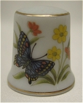 Click here to enlarge image and see more about item 237: Porcelain Butterfly Thimble