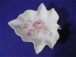 <b>Beautifully decorated with pink roses and subtle leaf designs.  Perfect for nuts or trinkets, this lefton piece is shape like a leaf.  Trimmed in gold.  Measures 6 in. across, 5.5 in. wide.  Shallow dish just over 1 in. tall.  Marked on bottom: Lefton China Hand Painted.  