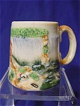 This tiny stein measures 2.5 in. tall.  The widest part measures 3inches in diameter not including handle.  This is a very old stein with a waterfall scene.  Handpainted.  Marked in green: Made in Japan.      Condition: Good.  Some crazing and there is a hairline crack.
