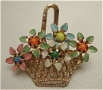 <b>Open weaved goldtone basket holding five flowers.  Colorful enamelled petals with center bead/stone accent.