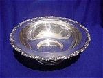 <b>Foot fruit bowl with floral trimmed rim.  By Oneida LTD Silversmiths.  Paper label on bottom. 