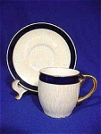 <b>Colors: Royal blue, iridescent white/cream and gold.  Saucer has a starburst pattern of iridescent white/cream with royal blue outer band.  Trimmed in gold.  Teacup has verticle pattern of iridescent white/cream with royal blue band on top of cup.  Trimmed in gold.  Tea cup is marked in green.  Majority of gold wear is on bottom ring on teacup
