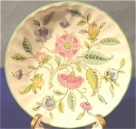 <b>Pattern: Haddon Hall Maker: Minton Design: Floral spray Colors: Pink, green, yellow, blue, purple and white  Bone China Made in England Trimmed in green Minton stamp on back in brown