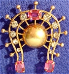 <b>Prong set rhinestones in pink and white accent this horseshoe pin/pendant.  Accent gold center ball with fanned out spindels   Wear as a pin or a pendant  Stamped on back:  1/20 12K M & S  Some of the white rhinestones have darkening edges