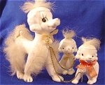 <b>A chain attaches this mama poodle and her babies together.  