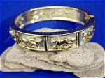 <b>Tastefully done gold plated bangle bracelet with brushed platinum color background highlighting the panthers.  Spring hinged bangle for easy opening and closing.  Panthers encircle the entire bangle.  Notice how change in lighting give this bangle different effects.