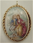 <b>This pendant/brooch has a classic courtship scene that was applied with a transfer, and accented touches of hand painting. 