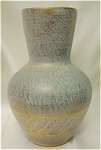 <b>This beautiful brushed gold vase was hand thrown and designed by Kay Hackett. 