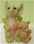 <b>This little dragon has a boo-boo, but never fear, both he and teddy were very brave!  Just look at their matching bandages.  Box has noticable wear and the lid has two tears along the closing flap.  Artist: Real Musgrave Series: General Stock: 00865