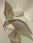 <b>Very stylish brooch crafted in mottled silvertone color and smooth, high gloss silver accent lines.  Elongated wing span and head dipped to create motion of flight. This is truly a beautiful, quality piece.  Marked: 1475