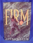The Firm by John Grisham.  The book is in very good condition.  There is some minor wear near the spine of the dust jacket.  There is a small inscribtion on the inside page (not by the author), a seal indention and it has been price clipped.  