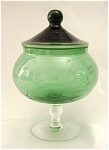 <b>Beautifully elegant green 2 piece dish with etched floral pattern.    Ball handle top fits snuggly on a round bowl with a short ball and stemmed foot.   As was typical of this era, there are a few small bubbles in the glass.   There are some noted flaws on the rim edge of bowl.  There are 4 minor flea bite chips, 3 on the inside of rim and 1 on the outside of rim.  There is what I believe is a factory flaw on the inside rim of lid.   The flaws are not visible with the lid on.  The picture has been enlarged to view the flaws easier.    Overall, this is a beautiful piece.  Maker: Unknown.  Do you know anything about this piece?  We appreciate your knowledge and look forward to hearing from you!