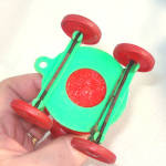 Click to view larger image of Rosen Santa on Wheels Christmas Candy Container Pull Toy (Image3)