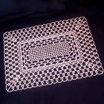 Click here to enlarge image and see more about item 11229: 4 Lustro Ware Pink Plastic Lace Doily Placemats