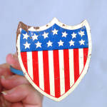 Click here to enlarge image and see more about item 11354-2: Union Shield Patriotic Flag Holder Radiator Ornament For Automobile