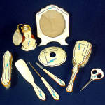 Click here to enlarge image and see more about item 11461: Art Deco Celluloid 9 Piece Vanity Dresser Set With Perfume, Frame