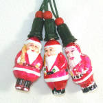 Click here to enlarge image and see more about item 11579: 3 Figural Milk Glass Santa Claus Christmas Light Bulbs