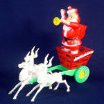 Click here to enlarge image and see more about item 11660: Rosen 1950s Santa's Candy Wagon Christmas Candy Container Display
