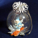Click here to enlarge image and see more about item 11878-2: Skiing Angel Dimensional Dome Scene Glass Christmas Ornament