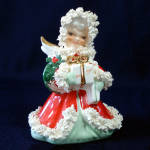 Click here to enlarge image and see more about item 12193-3: Napco Spaghetti Angel With Gifts Christmas Figurine