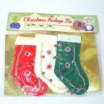 Click here to enlarge image and see more about item 12720A: Shiny Brite Package Christmas Stocking Money Holder Package Ties