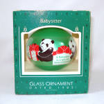 Click here to enlarge image and see more about item 13226: Hallmark 1985 Babysitter Glass Christmas Ornament in Box