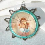 Click here to enlarge image and see more about item 13615: Scrap Angel Glass Diorama Christmas Ornament in Tinsel Star