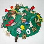 Click here to enlarge image and see more about item 13835: 1940s Child's Felt Beanie Hat With Cracker Jack Prize Charms