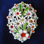 Click here to enlarge image and see more about item 14065: Flowered Rhinestone White Enamel Easter Egg Brooch Pin