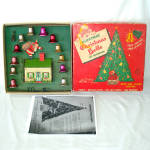 Click here to enlarge image and see more about item 14369: Criterion Electric Christmas Bells Santa on Tin House Set