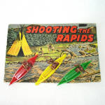 Click here to enlarge image and see more about item 14379: Shooting The Rapids Indians in Canoes 1940s Dimestore Toy