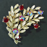 Click here to enlarge image and see more about item 14429: Lisner Layered Leafy Branches Red Rhinestone Brooch Pin