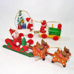 Click here to enlarge image and see more about item 14453: Painted Wood Santa Sleigh and Train Christmas Ornaments