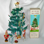 Click here to enlarge image and see more about item 14486: Santas Workshop 1960s Pixie Tinsel Tabletop Christmas Tree Set Boxed