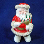 Click here to enlarge image and see more about item 14575: Ceramic Spaghetti Santa Claus With Dove Christmas Figurine