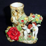 Click here to enlarge image and see more about item 3547: Figural Putti Cherubs Planter Vase with Applied Porcelain Roses